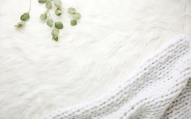 white throw blanket photo by Sarah Boudreau