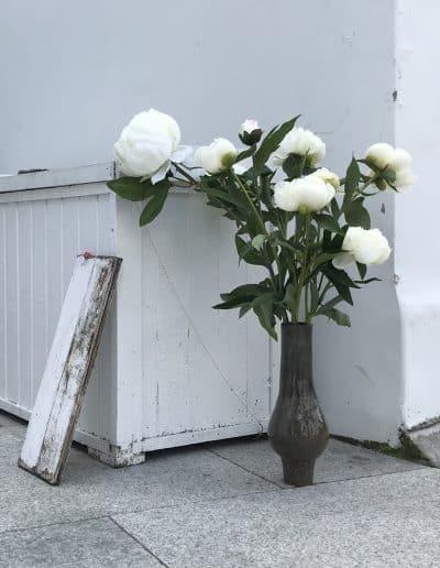 White peonies in handturned ceramic vase, London 2019