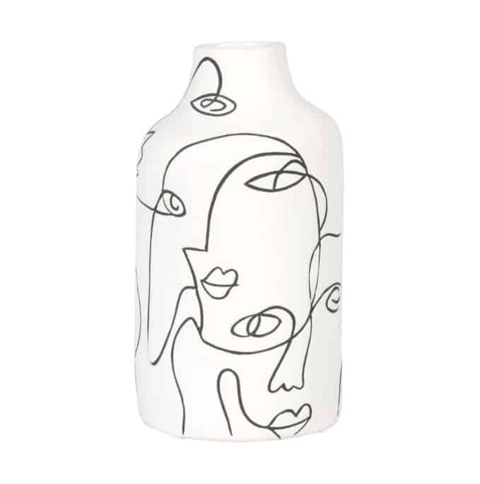 white and black dolomite face vase
