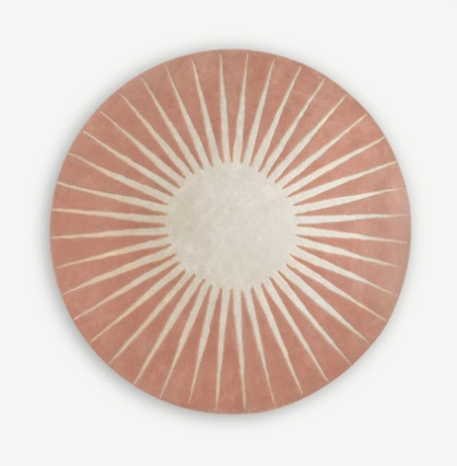 Round wool rug pink with star in centre