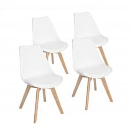 Four white minimalist dining chairs