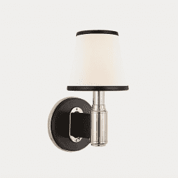 Wall mounted bedside lamp with cream shade