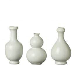 Three small off white vases